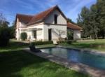 1 Vue côté maison piscine